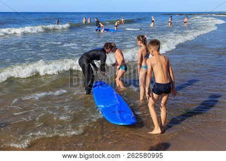 Zelenogradsk, Kaliningrad Region, Russia - July 29, 2017: Unknown Surfers With Surfboards And Unknow