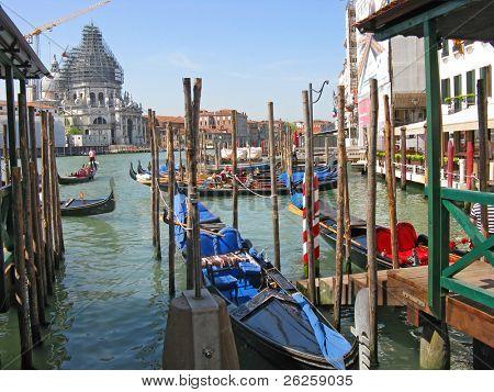 Gondolas moored at the grand canal at Venice Italy