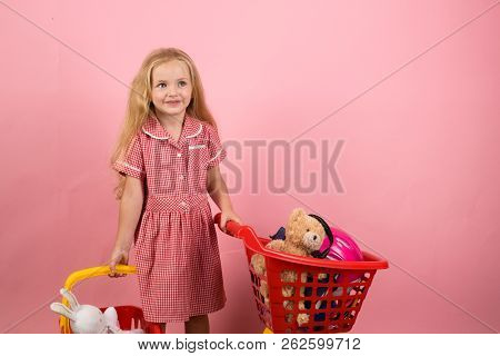 Shopping Is A Bit Of A Relaxing Hobby For Me. Little Girl Shopping. Little Shopaholic With Shopping