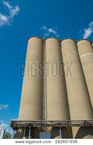 View of section of a grain elevator, an agrarian facility complex used to stockpile and store grain poster