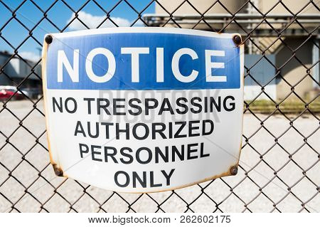 No Trespassing Warning Sign On Chain Link Fence