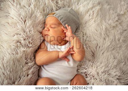 Baby Boy Kid Newborn Sleeping In Hat On Fluffy Blanket