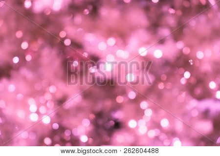 Pink Blurred Background With Bokeh Lights/closeup Of Blurred Pink Christmas Tree With Lights