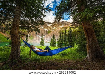 Girl Rests On A Hammock Looks At Dallas Peak Near Lower Blue Lake Ridgway Colorado