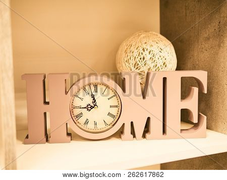 Home Decoration Of Letters Home, Clock And A Bowl Of Wicker From A Vine. Beautiful Writing Home With