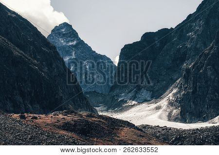 Glacier Azarova. Mountains Ridge Kodar, Pik Bam - The Highest Peak Of The Ridge Kodar In Transbaikal