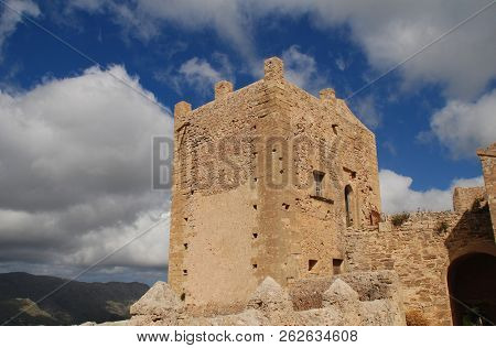 The tower of the monastery and church on the summit of the Puig de Maria at Pollensa on the Spanish island of Majorca.