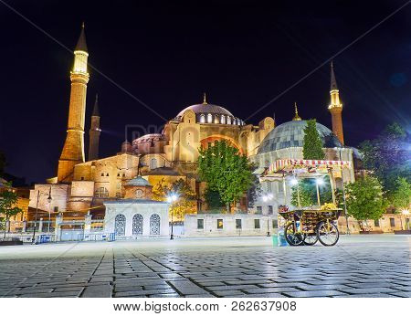 Istanbul, Turkey - July 11, 2018. The Hagia Sophia Mosque At Night With A Corn Cobs Stall In The For