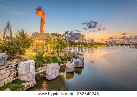 WICHITA, KANSAS - AUGUS 31, 2018: The confluence of the Arkansas and Little Arkansas River at the Keeper of the Plains near downtown Wichita at dawn.