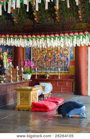 prayer in the buddhist Sinheungsa Temple in Seoraksan National Park, South korea