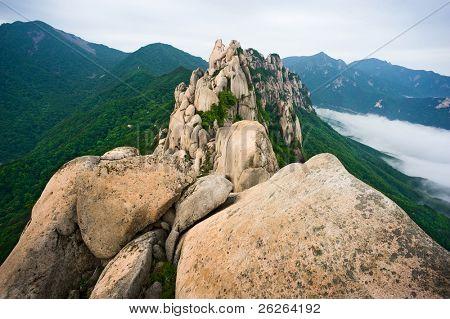 Famous Ulsanbawi Rock against the fog seorak mountains at the Seorak-san National Park, South korea