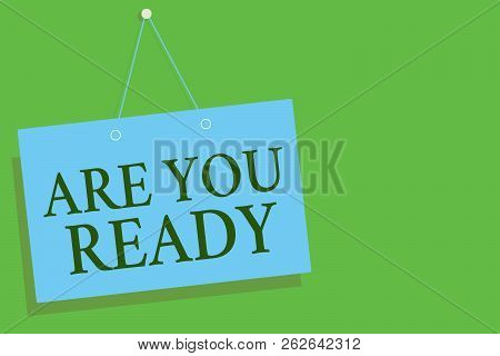Text sign showing Are You Ready. Conceptual photo Alertness Preparedness Urgency Game Start Hurry Wide awake Blue board wall message communication open close sign green background. poster