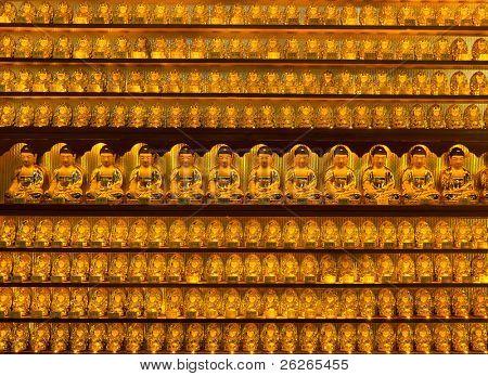 Golden buddha statues at Yakcheonsa Temple, Jeju Island, South Korea poster