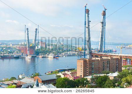 construction of big guyed bridge in the Russian Vladivostok over the Golden Horn bay