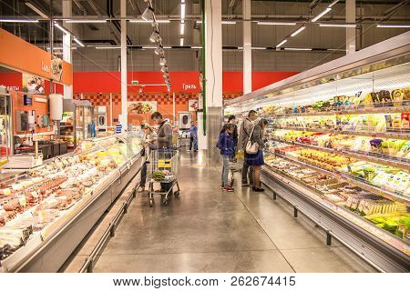 People Walk Around The Mall And Buy Food And Everyday Goods. Shop Selling Products. People With Shop