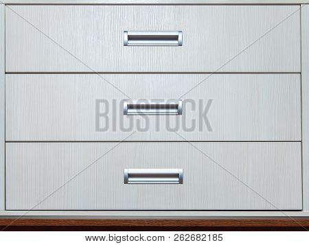 dresser of white color with wooden texture and sliding regiments for storage of things. poster