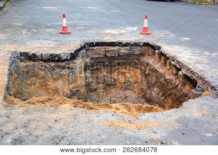 The Road Repair And Caution With Blocked Barrier Over Concrete Digging.