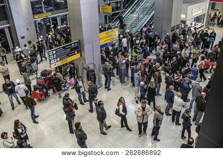 Guarulhos Sao Paulo, Brazil, August 01, 2018. People Await The Arrival Of Passengers In The Lobby Of