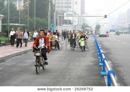 CHENGDU, CHINA - SEPTEMBER 16: Special line for bicyles, pedicabs and scooters as a result of enormous amount of vehicles on the road on September 16, 2006 in Chengdu, Sichuan, China
