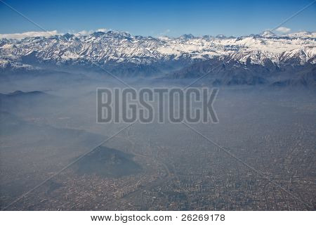 aerial view of Andes and Santiago with smog, Chile, focus on the mountains