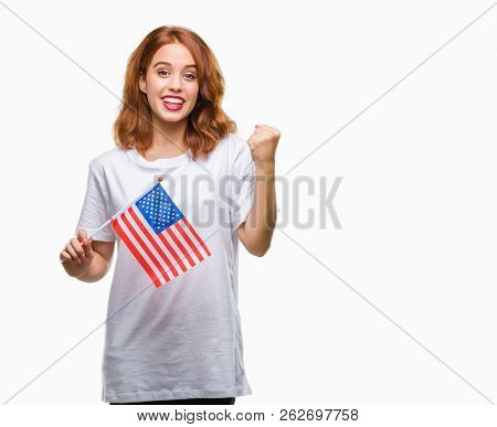 Young beautiful woman holding flag of america over isolated background screaming proud and celebrating victory and success very excited, cheering emotion