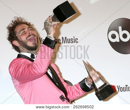 LOS ANGELES - OCT 9:  Post Malone at the 2018 American Music Awards at the Microsoft Theater on October 9, 2018 in Los Angeles, CA