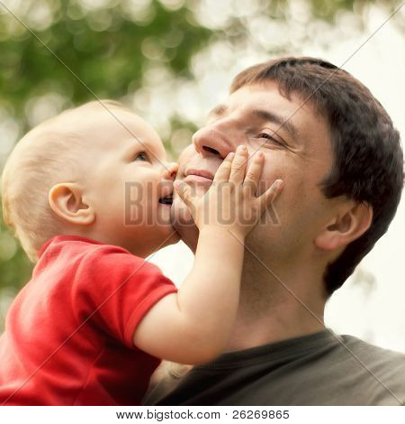 son kissing his father