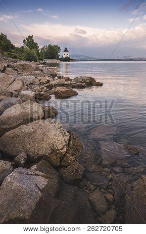 Church On Rocky Beach Of Liptovska Mara Lake In Slovakia