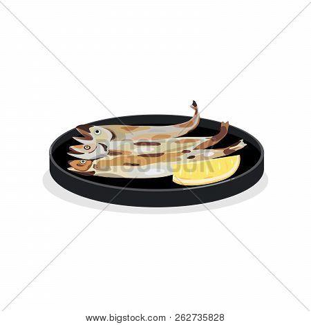 Japanese Tradition Salt Grilled Shishamo Fish Served With Fresh Lamon.