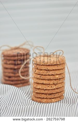 Cookie are stack and tied with twine. Delicious cookies on napkin background. Homemade cake. The nut cookie. poster