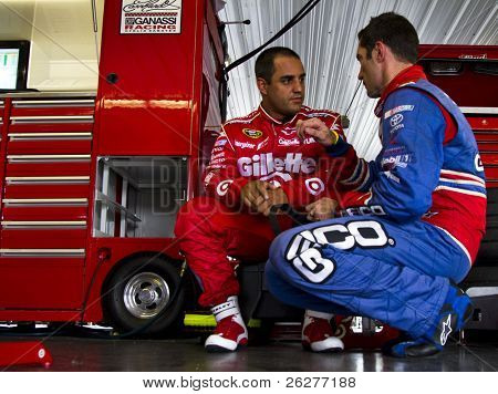 LONG POND, PA - JUNE 05:  Juan Pablo Montoya talks to Max Papis during practice for the Gillette Fusion ProGlide 500 race at the Pocono Raceway in Long Pond, PA on June 5th, 2010