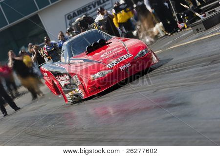 GAINESVILLE, FL - MARCH 13:  NHRA Funny Car driver, Jeff Diehl, brings his car down the track during the 41st Annual Gatornationals at the Gainesville Raceway in Gainesville, FL on Mar 13, 2010