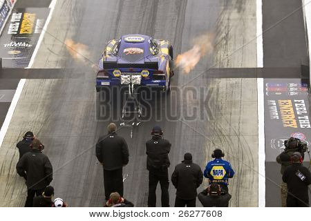 CONCORD, NC - MAR 28:  Ron Capps brings his NAPA Funny Car down the track at the zMax Dragway for the running of the inaugural Four-Wide Nationals event in Concord, NC on Mar 28, 2010