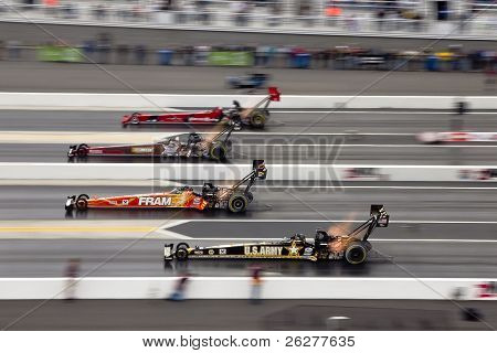 CONCORD, NC - MAR 28:  Joe Hartley, Doug Kalitta, Cor McClenathan, and Tony Schumacher race down the track at the zMax Dragway for the Four-Wide Nationals event in Concord, NC on Mar 28, 2010