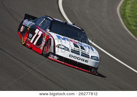 FONTANA, CA - OCT 08, 2010:  Sam Hornish, Jr. brings his Mobil 1 Dodge through the turns during a practice session for the Pepsi Max 400 race at the Auto Club Speedway in Fontana, CA on Oct 8, 2010.