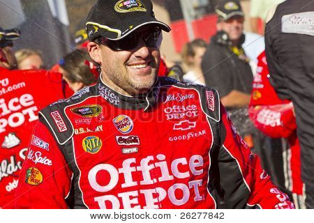 FONTANA, CA - OCT 10:  Tony Stewart holds off the rest of the Sprint Cup teams to win the Pepsi Max 400 race at the Auto Club Speedway in Fontana, CA on Oct 10, 2010.