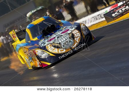 GAINESVILLE, FL - MAR 11:  Driver, Jim Head, brings his Funny Car race car down the track during a qualifying run for the Tire Kingdom NHRA Gatornationals race in Gainesville, FL on Mar 11, 2011
