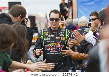 FONTANA, CA - MAR 27: Kyle Busch (18) walks through the line of fans before the start of the Auto Club 400 NASCAR Sprint Cup race at the Auto Club Speedway in Fontana, CA on Mar 27, 2011.