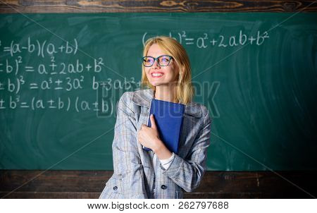 Cognition Process In Learning. Woman Teacher With Book In Front Of Chalkboard Think About Work. Cogn