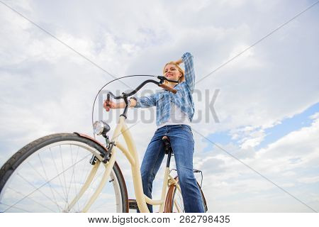 Girl Rides Bicycle Sky Background. Most Satisfying Form Of Self Transportation. Enjoy Cycling Cruise
