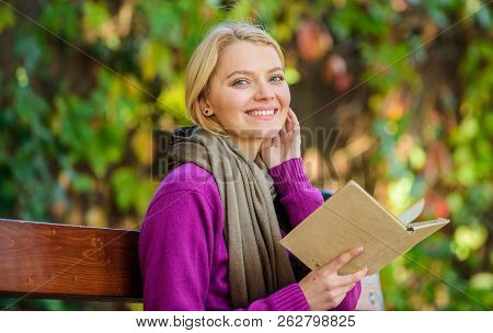 Lady Bookworm Read Book Outdoors Fall Day. Girl Sit Bench Relaxing With Book Fall Nature Background.