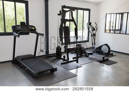 Private Gym At Home Interior With Different Sport Exercise Equipment