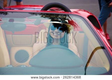 Beautiful girl in a Beautiful Car. Hot Sports Car with a Hot Model.