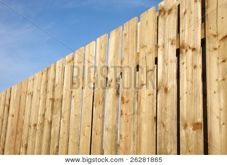 Wooden perimeter fence.