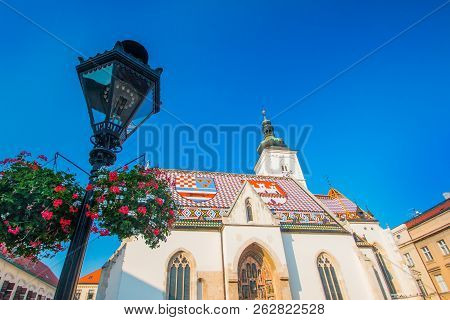 Zagreb, Croatia, church of St. Mark and flowers jardiniere. Upper town, Gornji Grad, historical part of old Zagreb poster