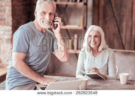 Portrait Of Elderly Man Talking On Mobile Phone
