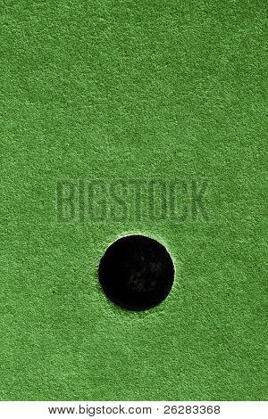 Crazy golf course hole with artificial grass.