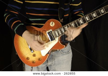 Playing Electric Guitar Fast