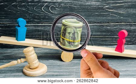 Divorce. Division Of Property By Legal Means. Man And Woman Are Standing On The Scales. Trial, Confl