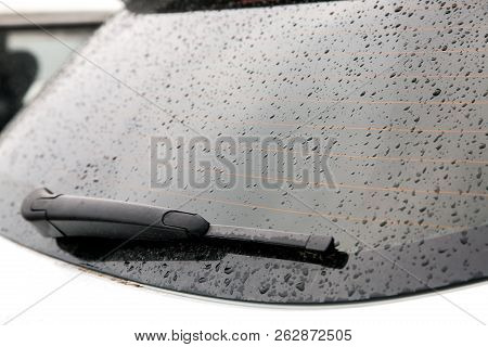 The Rear Window Of The Car Is Covered With Water Droplets After The Rain, The Heated Rear Window And